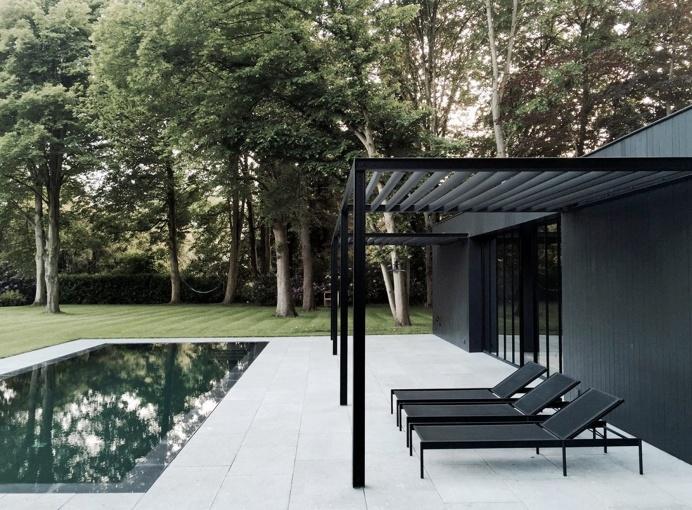 Pool patio with black steel pergola. CD Poolhouse by Marc Merckx. #pergola #pool #patio