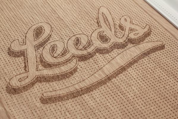 Leeds & Partners #cut #lettering #laser #wood #etching #passport #typography