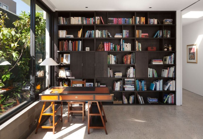 "remodelproj: ""Home office with full height bookcase surrounded by exterior greenery """