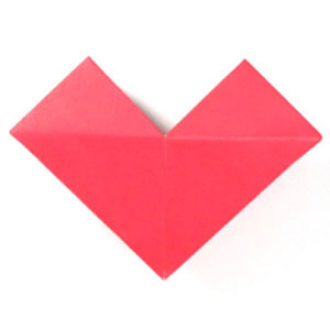 How to make a small origami heart (http://www.origami-make.org/howto-origami-heart.php)