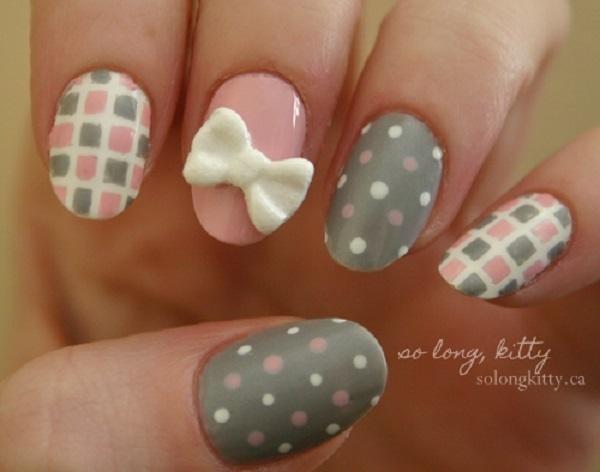 Cute checkered and polka dot bow nail art. Put in together cute bows, checkered prints and polka dots and you get this adorable nail art com