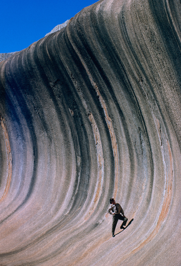 A wave of rock shaped by wind and rain towers above a plain in Western Australia, September 1963.Photograph by Robert B. Goodman, National G #rock #landscape #nat #nature #erosion #vintage #film #man #australia #geo