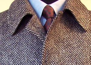 closeup_of_raglan_overcoat__large_brown_and_black_herringbone_front #herringbone #closeup #coat #menswear
