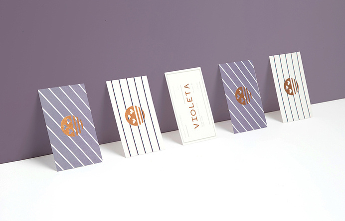 Logotype and business cards with copper foil detail designed by Anagrama for traditional Argentinian bakery Violeta