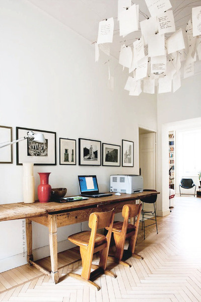 What appears like a very old desk outfitted with some modern amenities. #desk