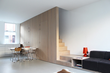 8A Architecten renovate house with combined staircase and sofa #interior #stairs