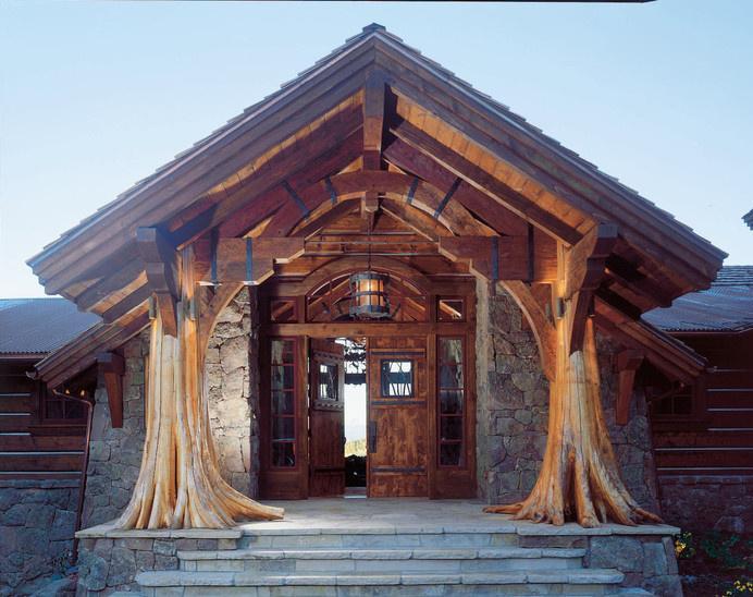 Tree stump entrance to house