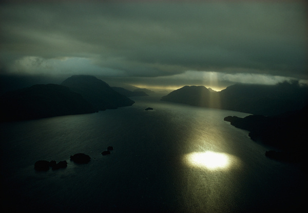 Aerial view of Dusky Sound near the southwestern tip of South Island in New Zealand, September 1971.Photograph by Gordon Gahan, National Geo #clouds #water #breakthrough #landscape #believe #photography #sunlight #spotlight #lake #abduction #rays #illumination