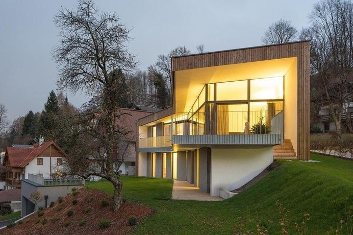Simple Geometric House with Two Profiles: House T in Salzburg, Austria #architecture