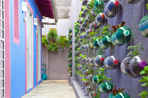 Urban Vertical Garden Built From Hundreds of Recycled Soda Bottles #guerillia #plant