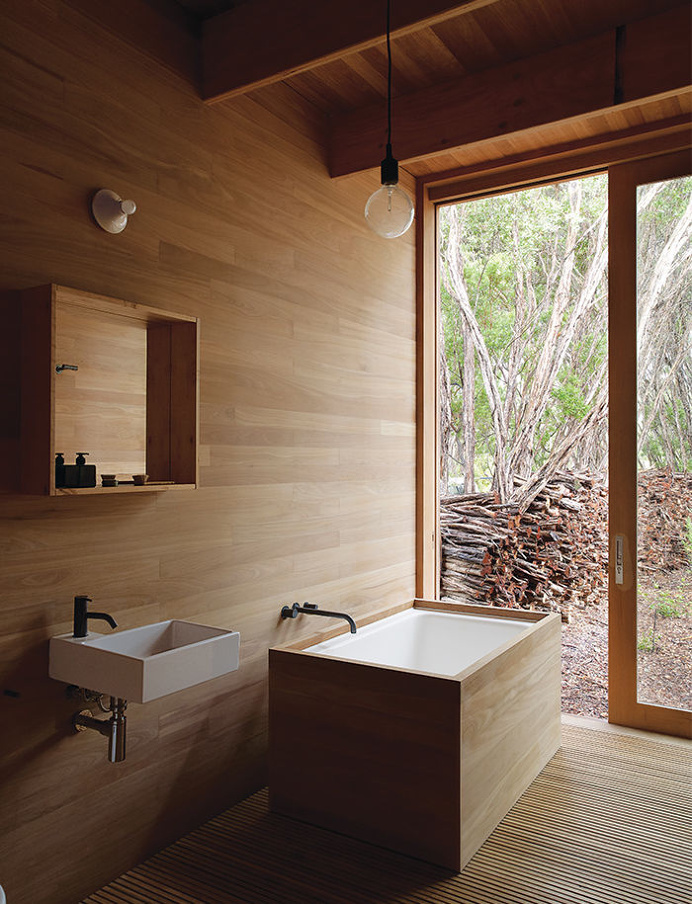 """Dwell: """"Local Wood Covers This Getaway for Two Architects"""""""