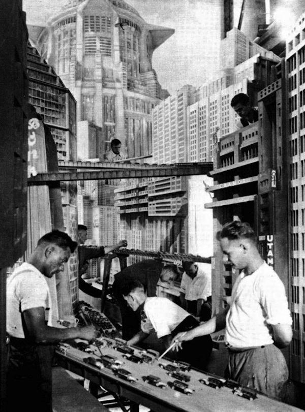 behind4 #city #futuristic #metropolis #set #skyscraper #photography #scenes #behind #film #prop #buildings #production