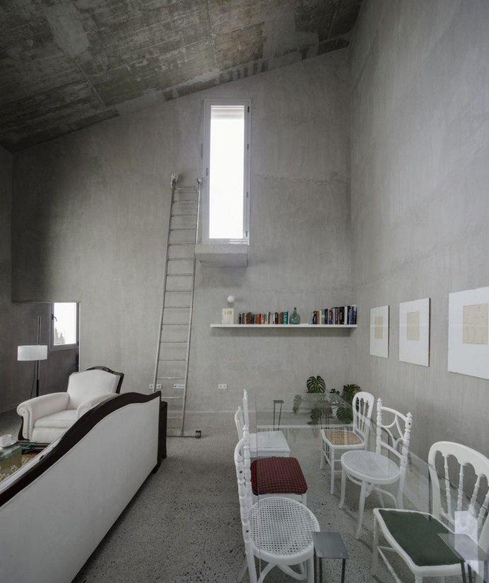 Elisa Valero Arquitectura Designed Eight Experimental Apartments with Exposed Concrete Walls 3