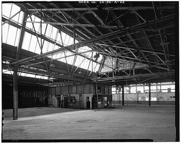 Ford Long Beach Assembly Plant TIME CLOCK AREA, WITH LUNCH ROOM IN DISTANCE. RAIL SPUR FOLDING DOORS ARE HIDDEN BEHIND OFFICE AT PHOTO CENTE #factories #structure #roofs #architecture #sawtooth