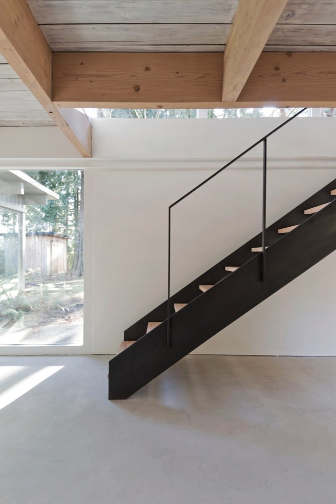 Black #steelstaircase with #woodentreads. #NorthVancouverHouse by #ScottAndScottArchitects. Photo courtesy of Scott & Scott Architects.