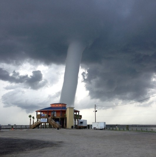 This photo provided by 'Buggie' Vegas, owner of Bridge Side Cabins and Marina in Grand Isle, La., shows a waterspout on Grand Isle, La. T #tornado #spout #water #whirlwind #photography #storm #nature