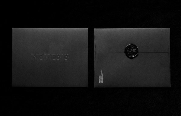 Logo and envelope with a wax seal and blind embossed detail designed by Anagrama for Latin American horror film production company Nemesis F #collateral #branding