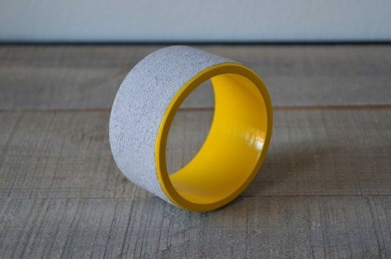 Concrete on wooden bangle in grey and yellow by cementology #bangle #wood #yellow #concrete