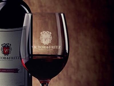 Dribbble - Victor Fritz Logo presentation by element media #bot #fritz #vine #bottle #wine #glass #victor