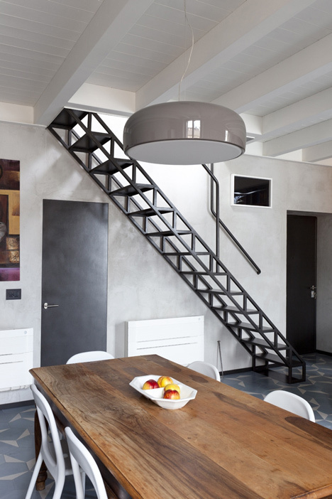 House with an iron staircase by Roberto Murgia and Valentina Ravara #interior