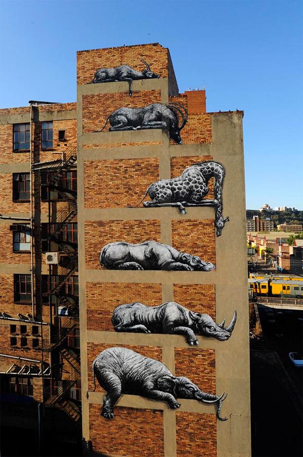 ROA Stacks African Animals on a Building Facade in Johannesburg #grafitti #white #pray #black #building #animals