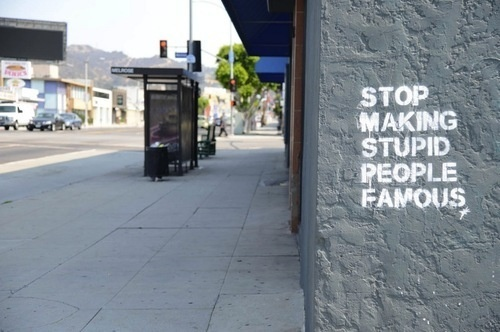 this isn't happiness™ photo caption contains external link #text #street #stencil #sentence #stupid #art #stop #fame
