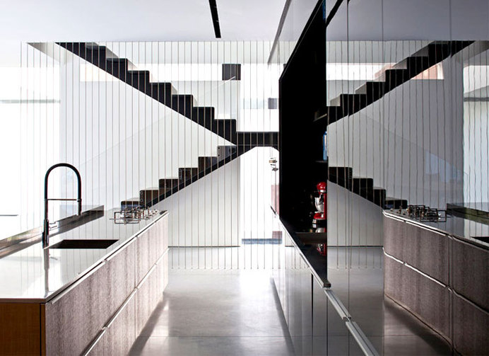 Party House Project by Pitsou Kedem Architects kitchen stylish black gray base #stairs #staircase #kitchen #design