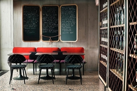 A Cocktail Bar That Evokes The 1960s Jet Set | Co.Design: business + innovation + design #interior #red #chairs #industrials #1960s