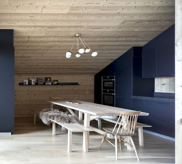 Trendy Alpine Cottage by Studio Razavi - InteriorZine