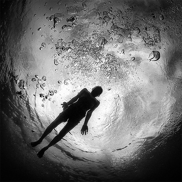 Black and white underwater photography by hengki koentjoro white bubbles black figure