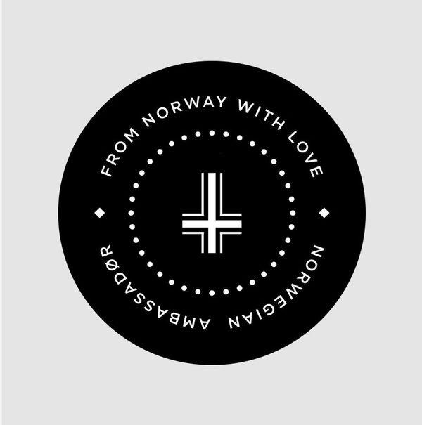 Norwegian Ambassadør — Top of the cork. 50% white, 50% black corks. Design by Sans Colour. #logo #branding #marque
