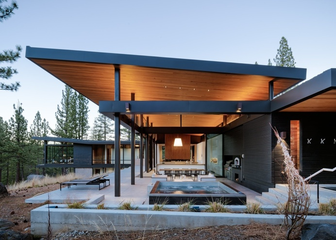Martis Camp Residence 1 outdoor patio designed by John Maniscalco Architecture PHOTOGRAPHER: Joe Fletcher