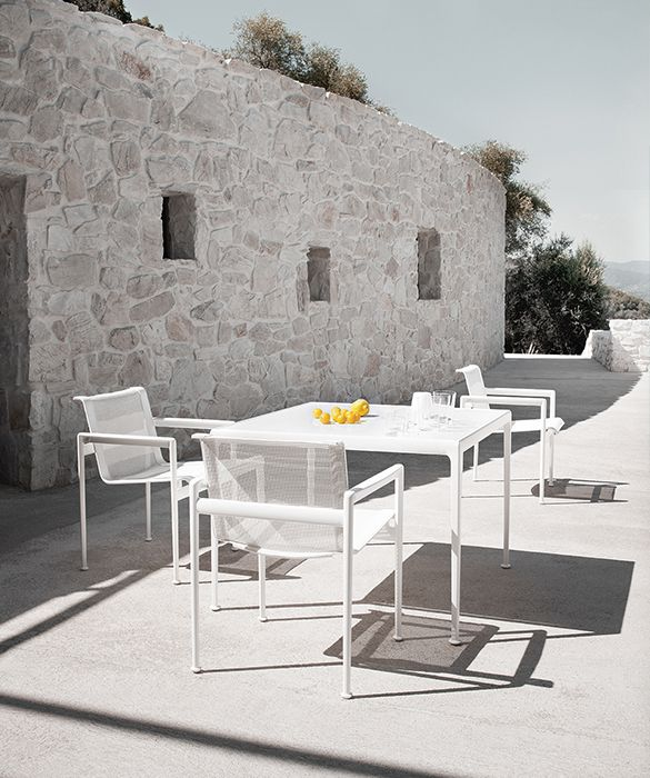 1966 outdoor dining table designed by Richard Schultz | twentytwentyone Seat in woven vinyl coated polyester mesh, aluminium frame with weather resistant polyester powder coat.