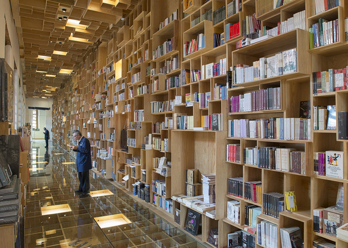 Mexican library renovation by Taller 6A with bookshop covered in boxes #interior
