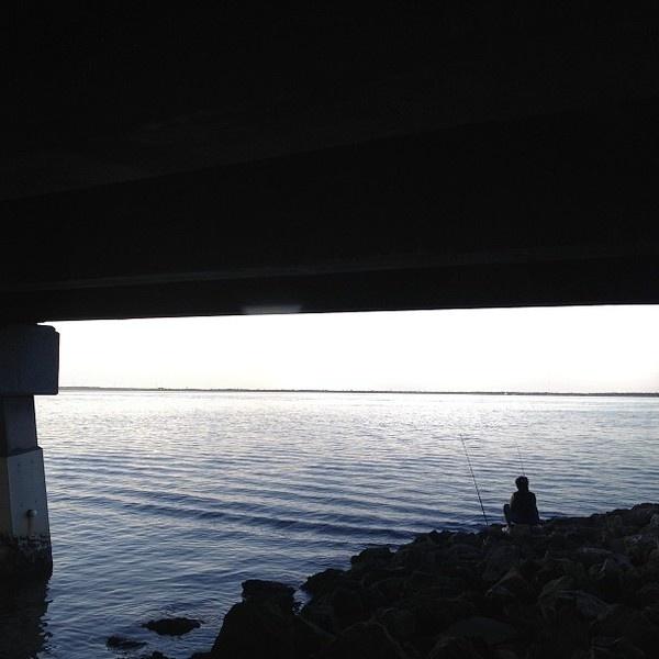 The lone fisher. #water #fisher #lone #bridge #alone #fishing