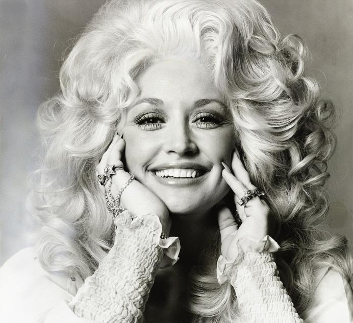 Dolly Parton smiling.