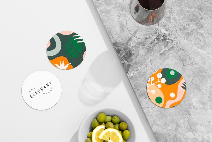 Logo, illustration and coaster design by Studio South for brasserie and courtyard bar Old Elephant House at Auckland Zoo