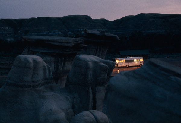 A mobile home shines amid eerie rock formations in Alberta, Canada, October 1970.Photograph by W.E. Garrett, National Geographic #formations #alberta #rock #home #nat #nature #mobile #vintage #film #geo #rv