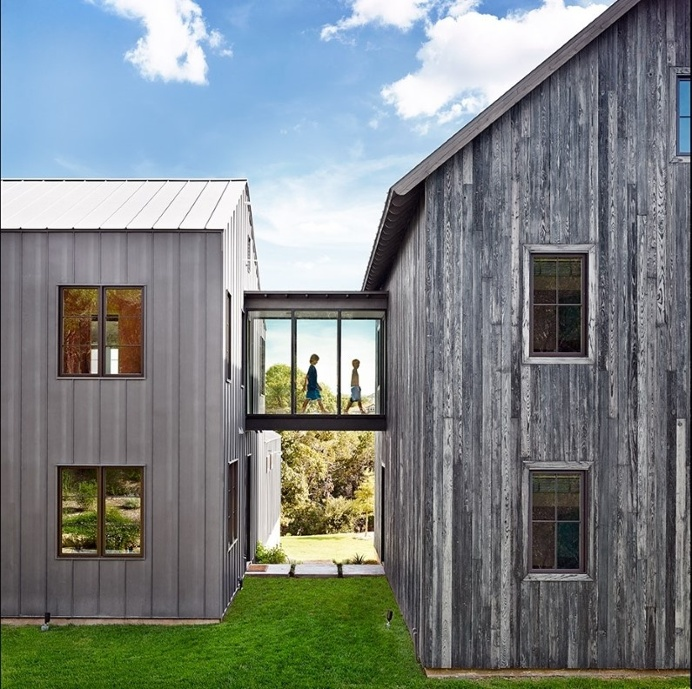 Farmhouse with minimalist glass and metal forms