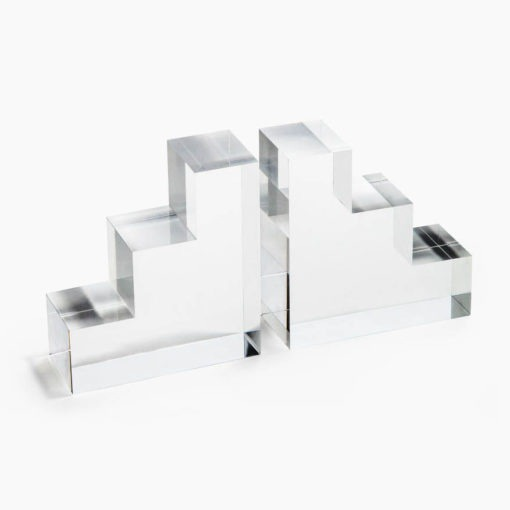 Lucite Bookends These Lucite Book Ends are a fantastic way to display your books atop a shelf. Featuring a stepped design, they elevate the space and add visual interest.