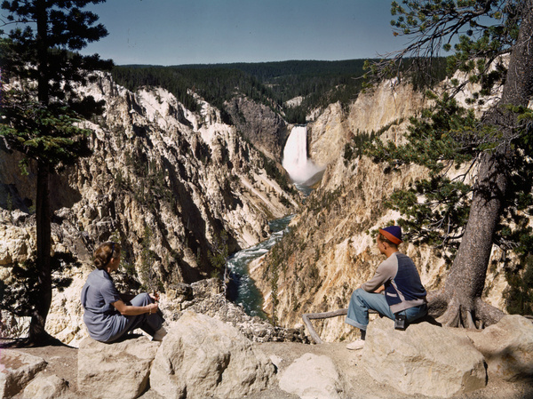 Vistors sit on an overlook to see scenic views in Yellowstone National Park, June 1940.Photograph by Edwin L. Wisherd, National Geographic