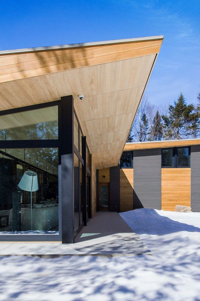 Wooden Wing Cottage in Quebec Perched on a Granite Bedrock 2