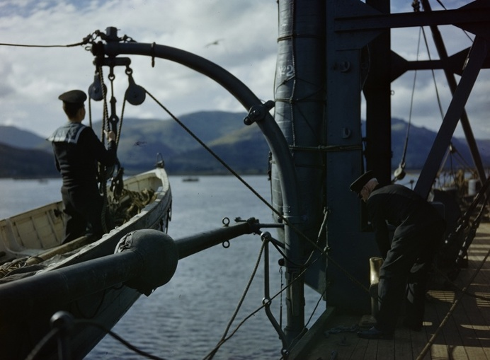 An officer and a rating launch a dinghy from HMS Forth on Holy Loch, Scotland