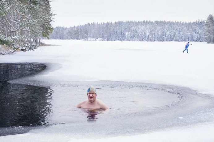 Winter Swimming in The Frozen Lake by Markku Lahdesmaki