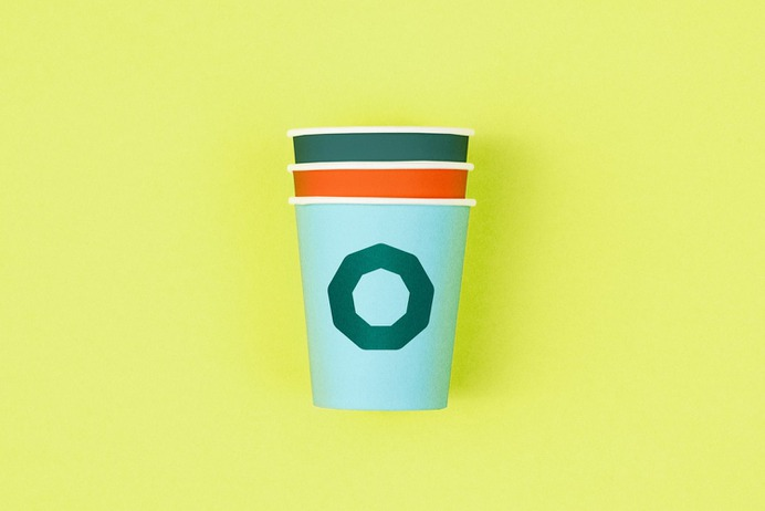 Logo and branded coffee cups designed by Werklig for professional banking tool Holvi