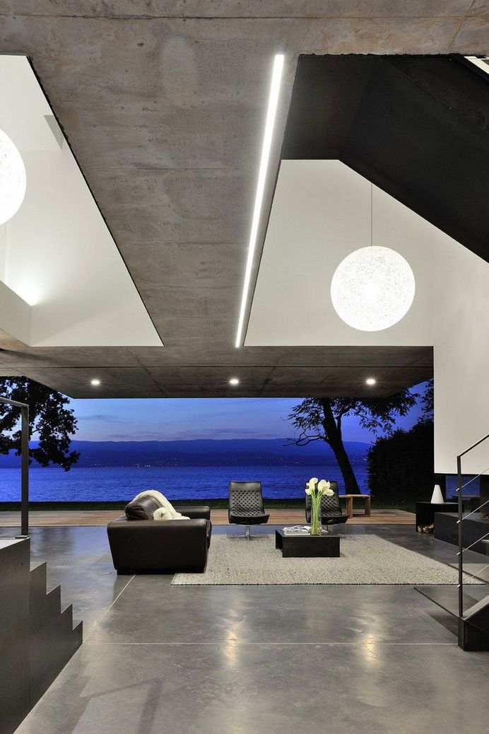 Contemporary Lake House Made Entirely of Raw Concrete 11