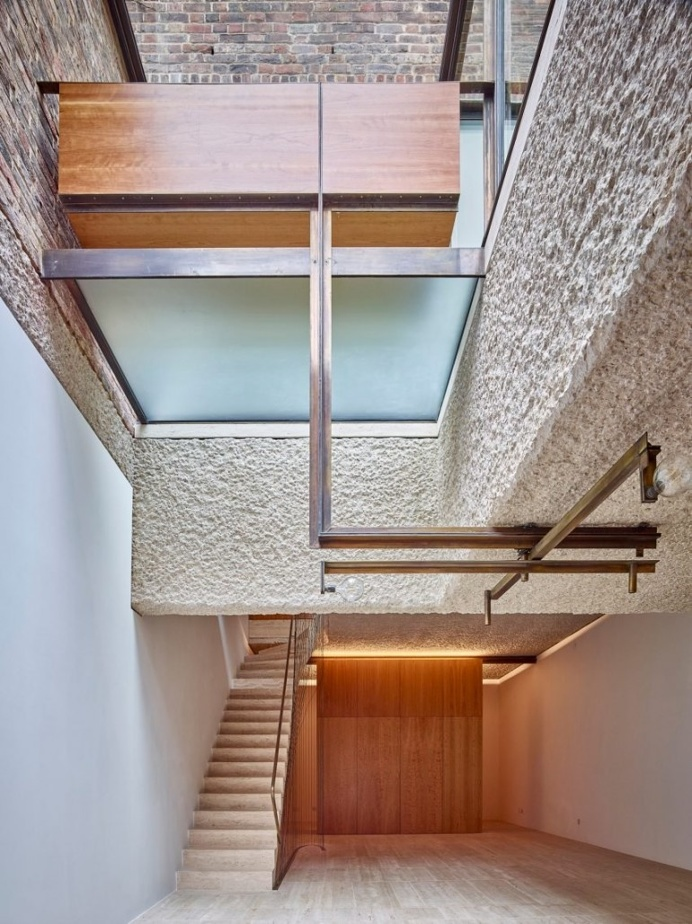 Amin Taha reconfigures London home around lightwells and a spiral stair