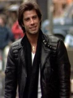 """John Travolta is a lovely Hero and Actor, who is Famous For His Romantic and Drama Film, """"Staying Alive"""". Hel Looked So Handsome in This Black Leather Jacket. #johntravolta #stayingalive #leatherjacket #blackjacket #blackleatherjacket #drama #romance #tonymanero #celebrity #fashion"""