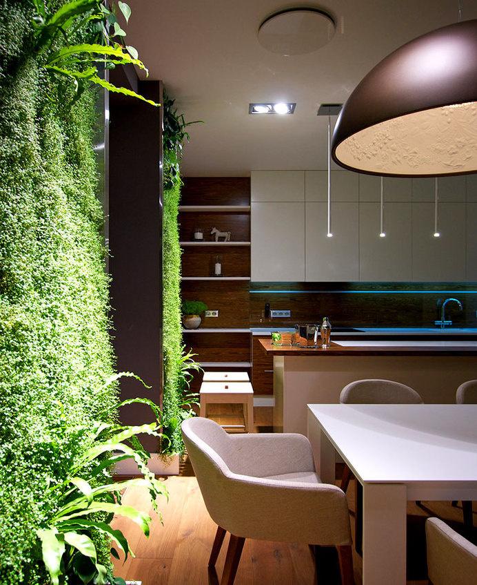 Sophisticated Studio Apartment by SVOYA Studioluxuriant green walls #interior #design #decor #home #wall #litchen #green