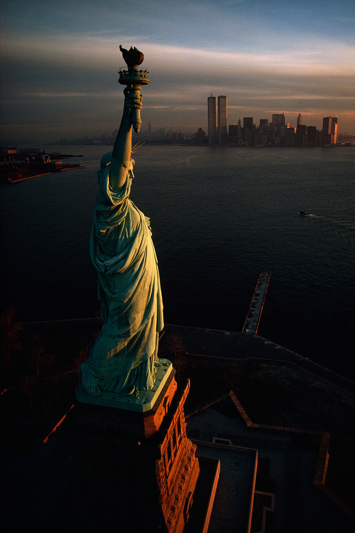 The Statue of Liberty hails dawn over New York Harbor in 1978.Photograph by David Alan Harvey, National Geographic Creative #statue #of #liberty